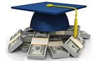 A graduation cap sitting atop bundles of cash.